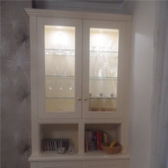 built in alcove cabinet with glass doors, glass shelves and downlighters