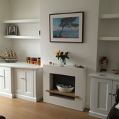 classic fitted white base cabinets with floating shelves