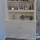 fitted alcove cabinet with display shelving above