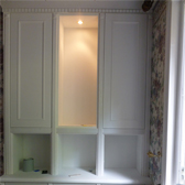 fitted alcove cabinet with panel doors and downlighters