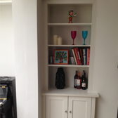fitted white cupboards with display shelving