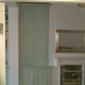full height storage alcove cupboards with panelled doors