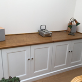 white fitted cabinets with oak top