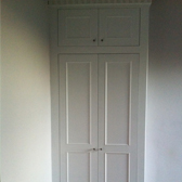 built in wardrobe with detailed top and base trims